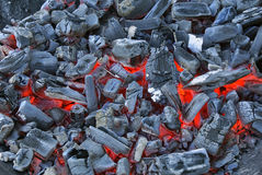 Smouldering charcoal ready for use Royalty Free Stock Image
