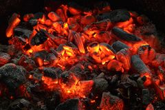 Smouldering coals. Actively smoldering embers of fire stock images