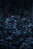 Smouldering coals at barbeque campfire. Smouldering coals at night ,Decaying charcoal, barbeque season Royalty Free Stock Photo