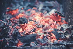 Smouldering coals at barbeque campfire. Smouldering coals at night ,Decaying charcoal, barbeque season Royalty Free Stock Images