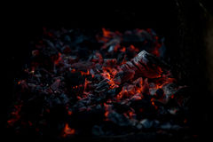 Smouldering coals at barbeque campfire. Smouldering coals at night ,Decaying charcoal, barbeque season Royalty Free Stock Image