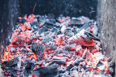 Smouldering coals at barbeque campfire. Smouldering coals at night ,Decaying charcoal, barbeque season Stock Photography