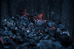 Smouldering coals at barbeque campfire. Smouldering coals at night ,Decaying charcoal, barbeque season Stock Photo
