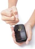做接收sms的拳头 库存图片