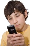 Sms. The boy with mobile phone royalty free stock photo