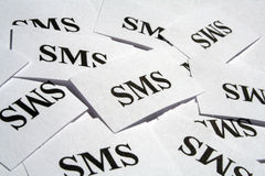 SMS. Many pieces of paper with special text on it Royalty Free Stock Photography