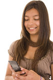 SMS. Young girl readind a SMS on his phone Royalty Free Stock Photos