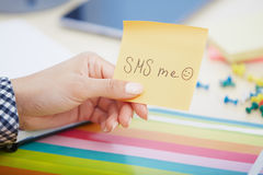 SMS me text on adhesive note Royalty Free Stock Photography