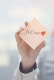 SMS me text on adhesive note Stock Photos
