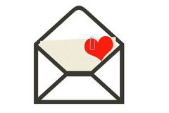 Sms with a pleasant surprise. The unpacked envelope, sticks out of it the letter with the attached heart to it. A background white Stock Photography
