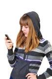 Sms que pulsan del adolescente Imagen de archivo libre de regalías