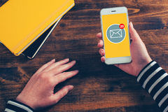 SMS receive notification on smartphone screen. Female hands using mobile phone Royalty Free Stock Image