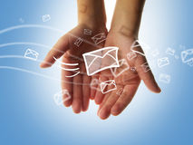 Sms sending. Many of messages flying in the air and touching the hand Royalty Free Stock Image