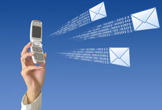 SMS sending. Woman's hand holding mobile phone. Phone is sending message Royalty Free Stock Photography