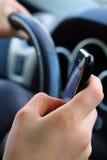 SMS sul andare Immagini Stock