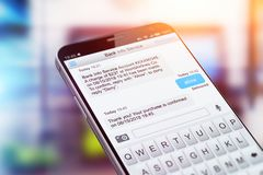 SMS text message app on smartphone screen Stock Photography