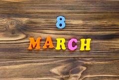 Smsa ` för `-8 marsch av plast- magnetiska bokstäver på träbakgrund Royaltyfria Bilder