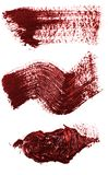 Smudge red oil paint on white. Set. Smudge red oil paint on white background. Set stock images