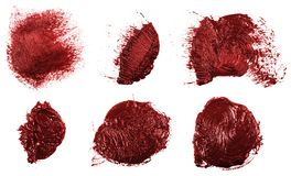 Smudge red oil paint on white. Set. Smudge red oil paint on white background. Set royalty free stock photos