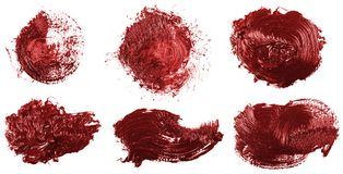 Smudge red oil paint on white. Set. Smudge red oil paint on white background. Set stock photos