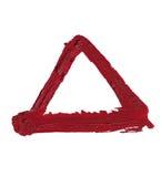 Smudged КРАСНАЯ форма треугольника губной помады на белой предпосылке Стоковые Изображения RF