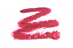 Smudged lipstick over white. Background Royalty Free Stock Image