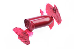 Smudged lipstick over white background. Close up of a Slice scratch burgundy lipstick Royalty Free Stock Photos