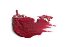 Smudged lipstick on white background Royalty Free Stock Photo