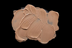 Smudged liquid foundation isolated on black Royalty Free Stock Images