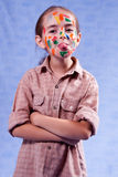 Smudged little painter. Showing tongue Royalty Free Stock Images