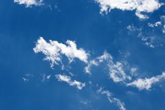 SMUDGES OF CLOUD. Small patches of bright white cloud Royalty Free Stock Photo