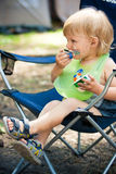 Smudgy baby boy eat in camp Royalty Free Stock Photography
