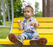 Smudgy funny boy eating ice-cream Royalty Free Stock Photos