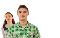 Smug young man being watched by his girlfriend Stock Images
