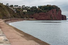 Smugglers cove near Teignmouth. Cliffs surrounding Smuggler`s Cove near the town of Teignmouth on the southern Devon coast in England as viewed from the sea wall stock photography