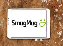 SmugMug company logo. Logo of SmugMug company on samsung tablet. SmugMug is a paid image sharing, image hosting service, and online video platform on which users royalty free stock image