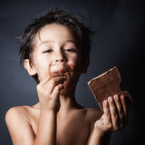 Smugy. Funny boy stained with chocolate Royalty Free Stock Photography