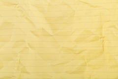 Smulad gul fodrad ren pappers- textur Royaltyfria Bilder