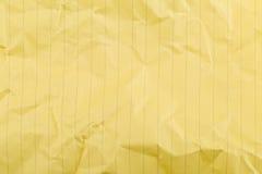 Smulad gul fodrad ren pappers- textur Arkivbilder