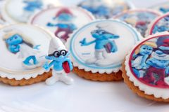 Smurf design gingerbread iced cookies. VARNA, BULGARIA DECEMBER 9, 2017: Pile of homemade Smurf design gingerbread iced cookies on a white plate with the focus Stock Photography