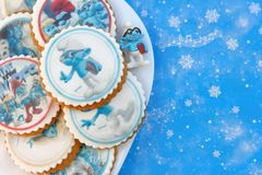 Smurf design gingerbread iced cookies. VARNA, BULGARIA DECEMBER 9, 2017: Pile of homemade Smurf design gingerbread iced cookies on a white plate with the focus Stock Image
