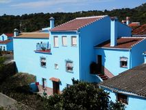 Smurf village blue painted houses Stock Photography
