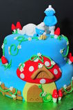 Smurfs cake figurines details Royalty Free Stock Images
