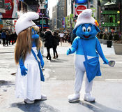 The Smurfs at Times Square. The Smurfs waiting for clients to be photographed with them at Times Square, NY Stock Image