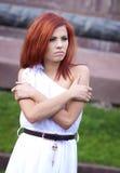 Smutna czerwona włosiana dziewczyna Fotografia Royalty Free