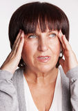 Smutna kobieta z migreną obrazy royalty free
