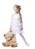 Smutna mała dziewczynka z miękkiej części zabawką Obraz Stock