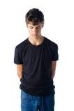 Smutna nastolatek chłopiec gruntująca patrzeć w dół fotografia royalty free
