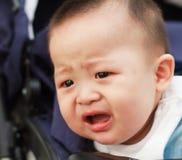 Smutny śliczny azjatykci dziecko ogląda out Obrazy Stock