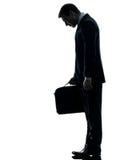 Smutny biznesowy mężczyzna patrzeje w dół sylwetkę Zdjęcia Stock
